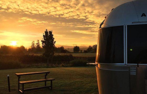 RV trailer in sunset campsite